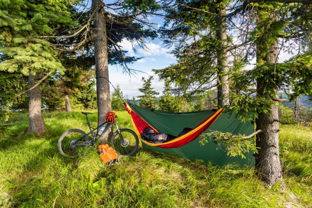 camping with hammock in summer woods on bike P7X54SR