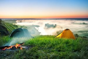 tent camping on hill over misty river PQB6XP3