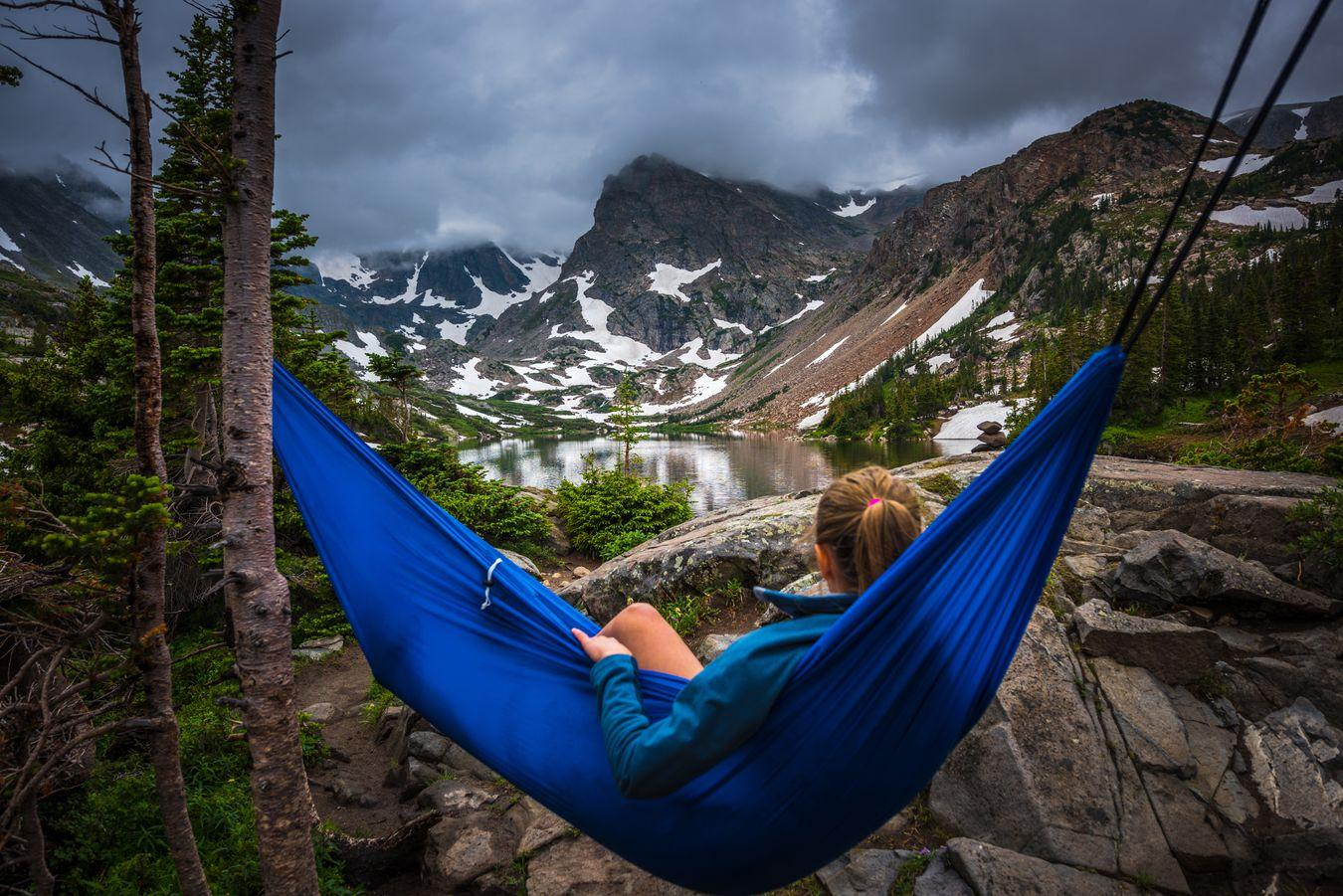 woman relaxes on a hammock lake isabelle colorado PBTDQMB