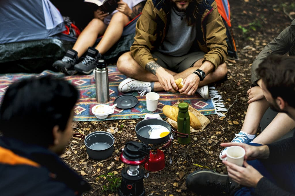 friends camping in the forest together MDJFLYB