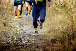 group runners running uphill PMRQAGA