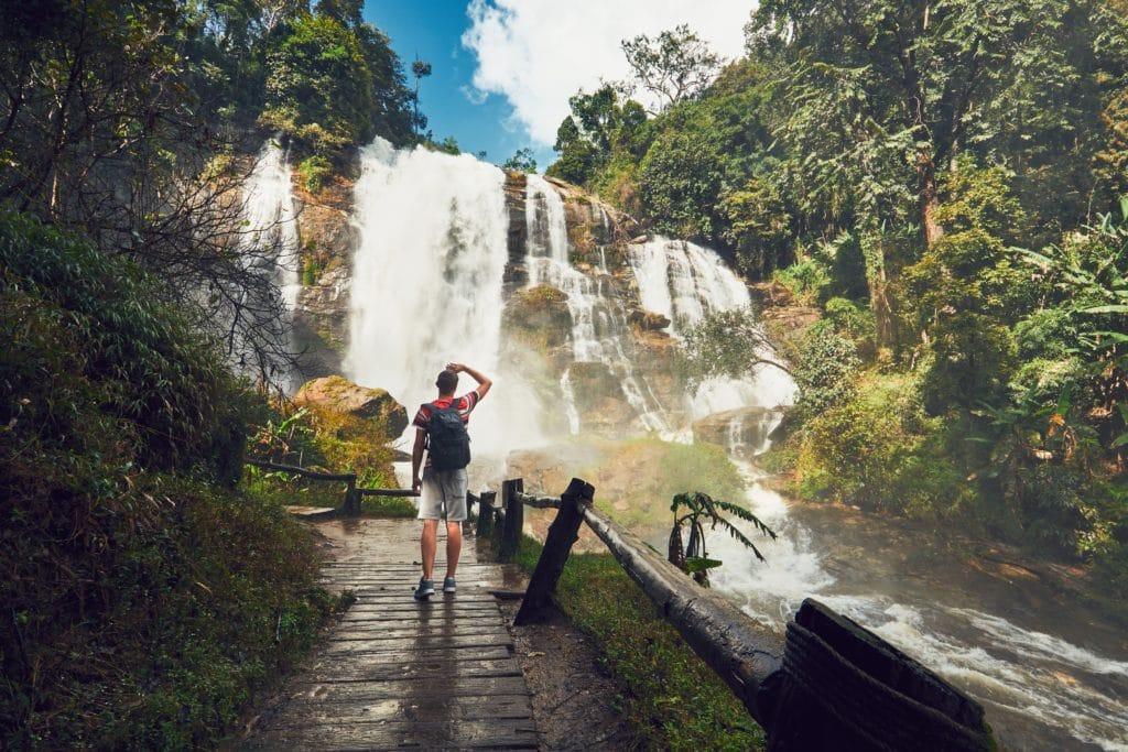 traveler near waterfall PQMSW8P